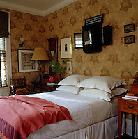 This guest bedroom is decorated with antique furniture and folk art
