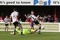 An own goal by Brad Walker of Wrexham makes the score 1-1 during Dagenham & Redbridge vs Wrexham, Vanarama National League Football at the Chigwell Construction Stadium on 13th October 2018