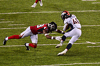 Canton, Ohio - August 1, 2019: Atlanta Falcons defensive back Jordan Miller #28 tackles Denver Broncos running back Devontae Jackson #48 during a pre-season game at the Tom Benson Hall of Fame stadium in Canton, Ohio August 1, 2019. This game marks start of the 100th season of the NFL. (Photo by Don Baxter/Media Images International)