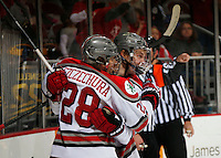 OSU Alex Szczechura celebrates teammates Ryan Dzingel in the second period at Value City Arena in Columbus Dec. 2, 2013.