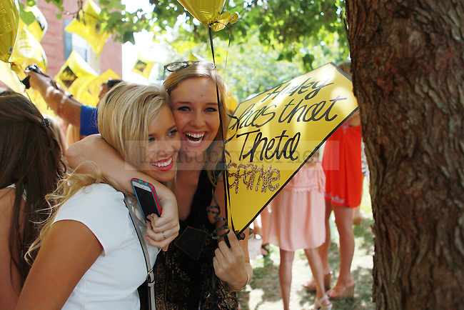 Members of Kappa Alpha Theta embrace at sorority bid day in Lexington, Ky., on Friday, August 21,  2015. Photo by Emily Wuetcher | Staff