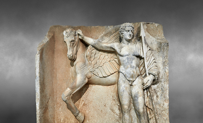 "Close up of a Roman Sebasteion relief  sculpture of  Bellerophon Aphrodisias Museum, Aphrodisias, Turkey. Against a grey background.<br /> <br /> Bellerophon was a Lykian hero and was claimed as a founder of Aphrodisias. He holds his winged horse Pegasos. The deign was modelled on another relief panel in the series ""Royal hero with Dod Hunting"". The carving is poor and the sculptor may have been a novice.modelled"