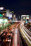 Traffic races through a major junction in central Tokyo, Japan on 05 Feb. 2012. Photographer: Robert Gilhooly