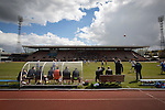 The home team's technical area watch the first-half action during the Scottish pyramid play-off second leg between Edinburgh City (in white) and Cove Rangers at the Commonwealth Stadium at Meadowbank in Edinburgh. The match between the champions of the Lowland and Highland Leagues determined which club would play-off against East Stirlingshire for a place in the Scottish league. The second leg ended 1-1, giving Edinburgh City a 4-1 aggregate win.