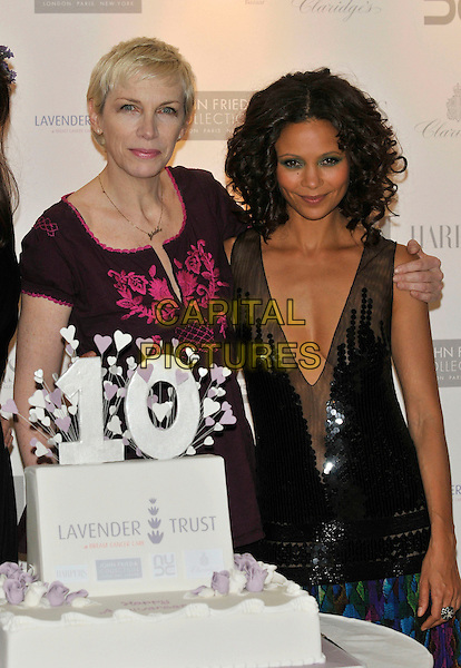 ANNIE LENNOX & THANDIE NEWTON.10th Anniversary Party of the Lavender Trust at Breast Cancer Care, .Claridges Hotel, London, England, UK.1st May 2008..half length cake low cut plunging neckline black sequined 10 ten .CAP/PL.©Phil Loftus/Capital Pictures