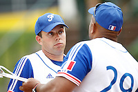 21 June 2011: Jerome Debrais of Team France talks to Carlos Jiminian as he pitches against UCLA Alumni during UCLA Alumni 5-3 win over France, at the 2011 Prague Baseball Week, in Prague, Czech Republic.
