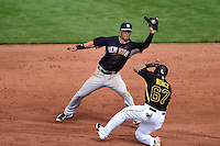 New York Yankees second baseman Rob Refsnyder (98) catches a throw as Gustavo Nunez (67) slides in during a Spring Training game against the Pittsburgh Pirates on March 5, 2015 at McKechnie Field in Bradenton, Florida.  New York defeated Pittsburgh 2-1.  (Mike Janes/Four Seam Images)