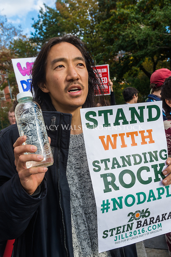 New York, USA 6 Nov 2016 - New York Stands with Standing Rock - Environmentalists, Human rights activists, Native Americans and people of faith gathered rallied in Washington Square in support of the water protectors in Standing Rock, South Dakota.<br /> <br /> The Dakota Access Pipeline Project is a new approximate 1,172-mile pipeline that will connect the rapidly expanding Bakken and Three Forks production areas in North Dakota to Patoka, Illinois.<br /> <br /> Since April 2016, hundreds of demonstrators have been arrested, and the Oceti Sakowin Camp in Cannon Ball, North Dakota, has drawn thousands more, including Native Americans, environmental activists and celebrities.<br /> <br /> Many Sioux Tribes say that the pipeline threatens the Tribe&rsquo;s environmental and economic well-being, and would damage and destroy sites of great historic, religious, and cultural significance.