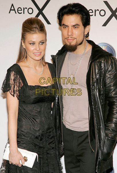 CARMEN ELECRTRA & DAVE NAVARRO.At SAAB event to introduce their new concept vehicle, the AERO X, and announces Philanthropic Partnership with Angel Flight America at the Altman Building, New York, NY, USA, 10th April 2006.  .half length black dress lace white bag husband wife married .Ref: ADM/JL.www.capitalpictures.com.sales@capitalpictures.com.©Jackson Lee/AdMedia/Capital Pictures.