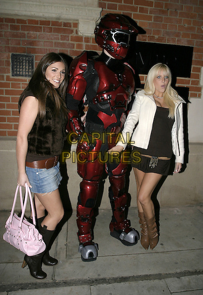 LUCY PINDER & MICHELLE MARSH.Leaving the Halo 2 VIP Launch, Hospital Project, Endell Street, London, 3rd November 2004..full length funny touching robot man rude.Ref: AH.www.capitalpictures.com.sales@capitalpictures.com.©Capital Pictures...