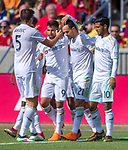 Los Angeles FC forward Diego Rossi (9) is congratulated by his teammates for his first of two goals against Real Salt Lake in the first half Saturday, March 10, 2018, during the Major League Soccer game at Rio Tiinto Stadium in Sandy, Utah. LAFC beat RSL 5-1. (© 2018 Douglas C. Pizac)