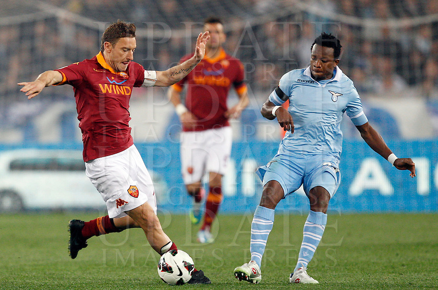 Calcio, Serie A: Roma vs Lazio. Roma, Stadio Olimpico, 8 aprile 2013..AS Roma forward Francesco Totti, left, is challenged by Lazio midfielder Ogenyi Onazi, of Nigeria, during the Italian serie A football match between A.S. Roma  and Lazio at Rome's Olympic stadium, 8 april 2013..UPDATE IMAGES PRESS/Riccardo De Luca