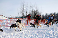 Sunday February 27, 2010   Aniton Guillrrno leaves the start line of the Junior Iditarod at Willow Lake, Alaska