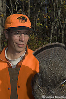 Hunter displaying ruffed grouse tail feathers