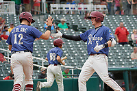 Frisco RoughRiders Josh Altman (5) high fives Charles Leblanc (12) after hitting a home run during a Texas League game against the Midland RockHounds on May 21, 2019 at Dr Pepper Ballpark in Frisco, Texas.  (Mike Augustin/Four Seam Images)