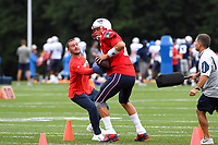 August 1, 2018: New England Patriots quarterback Tom Brady (12) works with coaching staff on a drill at the New England Patriots training camp held on the practice fields at Gillette Stadium, in Foxborough, Massachusetts. Eric Canha/CSM