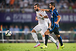 (L) Jese Rodriguez of Real Madrid CF competes for the balding (R) Martin Motoya of FC Internazionale Milano during the FC Internazionale Milano vs Real Madrid  as part of the International Champions Cup 2015 at the Tianhe Sports Centre on 27 July 2015 in Guangzhou, China. Photo by Aitor Alcalde / Power Sport Images