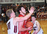 RICK PECK/SPECIAL TO MCDONALD COUNTY PRESS<br /> McDonald County's Cooper Reece gets past Nevada's Dalton Gayman (31) and Logan McNeley (5) to score two of his game-high 26 points in the Mustangs 62-52 loss to Nevada on Feb. 8 at Nevada High School.
