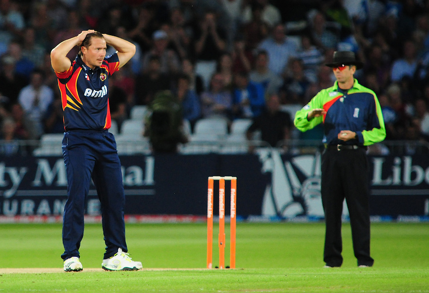 Essex Eagles' Graham Napier looks dejected after being hit for a boundary by Nottinghamshire Outlaws' Alex Hales <br /> <br />  (Photo by Chris Vaughan/CameraSport) <br /> <br /> County Cricket - Friends Life t20 Quarter-final - Nottinghamshire Outlaws v Essex Eagles - Thursday 8th August 2013 - Trent Bridge - Nottingham<br /> <br /> &copy; CameraSport - 43 Linden Ave. Countesthorpe. Leicester. England. LE8 5PG - Tel: +44 (0) 116 277 4147 - admin@camerasport.com - www.camerasport.com