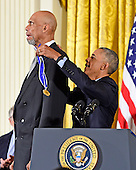 United States President Barack Obama presents the Presidential Medal of Freedom to former NBA star Kareem Abdul-Jabbar during a ceremony in the East Room of the White House in Washington, DC on Tuesday, November 22, 2016.  The Presidential Medal of Freedom is the Nation's highest civilian honor.<br /> Credit: Ron Sachs / CNP