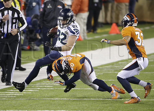 02.02.2014. East Rutherford, NJ, USA. Luke Willson (82) of the Seattle Seahawks is tackled by Mike Adams (20) of the Denver Broncos during the second half of Super Bowl XLVIII at MetLife Stadium in East Rutherford, N.J., on Sunday, Feb. 2, 2014