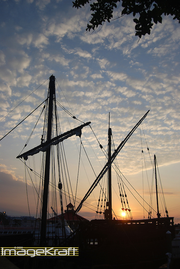 Ship masts and sky at sunrise in Lewes, Delaware canal
