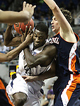 Nevada's Dario Hunt gets fouled by Bucknell's Mike Muscala during a second round NIT college basketball game on Sunday, March 18, 2012, in Reno, Nev. Nevada won 75-67..Photo by Cathleen Allison