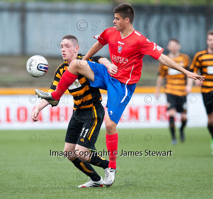 Alloa's Declan McManus and Cowdenbeath's Lewis Milne challenge for the ball.