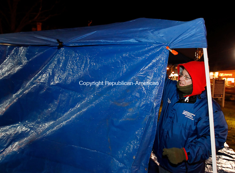 "Windsted, CT-15 December 2012-121512CM04-  Winsted Town Manager, Dale L. Martin, right, helps erect a tarp on East End Park Friday night in Winsted.  The duo were among several area officials who were participating in ""Freezin' for   Reason"", which is aimed at promoting awareness to homelessness by staying over night in the cold.   Christopher Massa Republican-American"