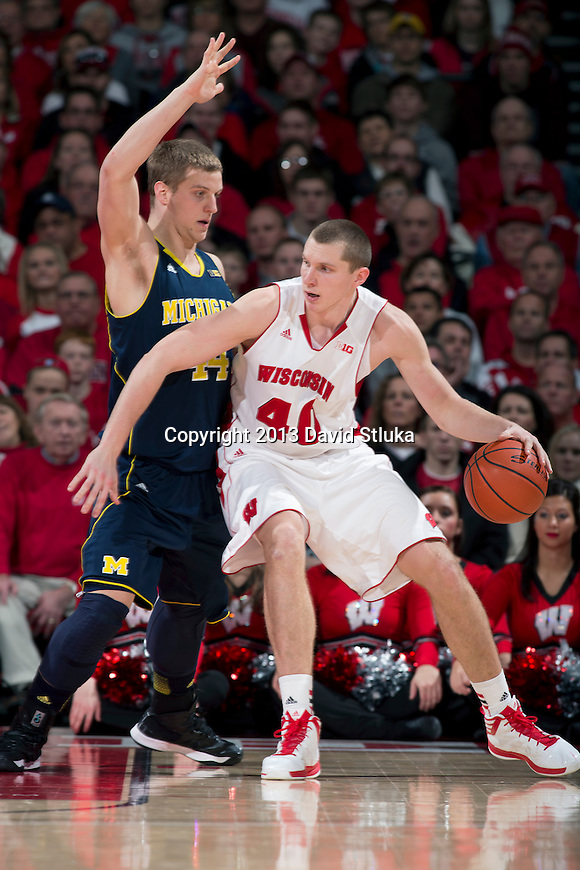 Wisconsin Badgers forward Jared Berggren (40) handles the ball during a Big Ten Conference NCAA college basketball game against the Michigan Wolverines Saturday, February 9, 2013, in Madison, Wis. The Badgers won 65-62 (OT). (Photo by David Stluka)