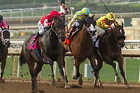 ARCADIA, CA  JANUARY 07: #8 Midnight Bisou, ridden by Mike Smith, takes on #7 Win the War, ridden by Tyler Gaffalione, and #2 Steph Being Steph, ridden by Stewart Elliott, in the stretch  of the Santa Ynez Stakes (Grade ll) on January 7, 2018, at Santa Anita Park in Arcadia, CA. (Photo by Casey Phillips/ Eclipse Sportswire/ Getty Images)