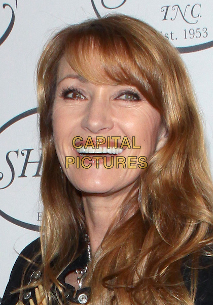 JANE SEYMOUR .Share's 57th Annual Boomtown Gala held at  Santa Monica Civic Auditorium,  Santa Monica, California, USA, .5th June 2010..portrait headshot  black smiling mouth open fringe .CAP/ADM/TC.©T. Conrad/AdMedia/Capital Pictures.