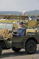 Historical vehicle and Bird Dog (background) at Kjeller. Norwegian Spitfire Foundation invited Norwegian WWII  Spitfire veterans to fly in Spitfire, at the historical airfield Kjeller in Norway.