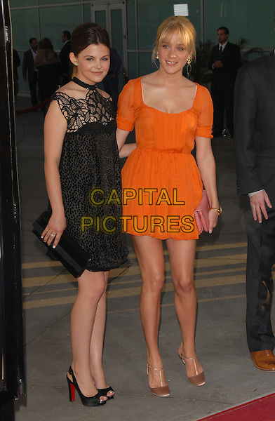 """GINNIFER GOODWIN & CHLOE SEVIGNY (wearing Vintage Prada).The Premiere of The HBO Original Series """"Big Love"""" held at The Cinerama Dome in Hollywood, California, USA..June 7th, 2007                .full length black pattern dress red lace off the shoulder crochet clutch purse orange t-bar t bar shoes .CAP/DVS.©Debbie VanStory/Capital Pictures"""