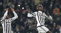 Calcio, Champions League: Gruppo D - Juventus vs Manchester City. Torino, Juventus Stadium, 25 novembre 2015. <br /> Juventus&rsquo; Patrice Evra, left, and Paul Pogba greet fans at the end of the Group D Champions League football match between Juventus and Manchester City at Turin's Juventus Stadium, 25 November 2015. Juventus won 1-0.<br /> UPDATE IMAGES PRESS/Isabella Bonotto