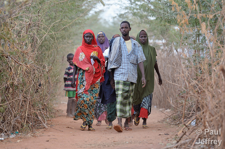 Residents walking along a path in the Dadaab refugee camp in northeastern Kenya. Tens of thousands of newly arrived Somalis who have swelled the population of what was already the world's largest refugee camp.