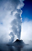 CASTLE GEYSER ERUPTS ON A COLD MORNING IN YELLOWSTONE NATIONAL PARK,WYOMING