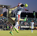 CARY, NC - MARCH 22: Atlas's Luis Robles (MEX) (18) and Carolina's Brian Sylvestre (92) challenge for a cross in the penalty area. The NASL's North Carolina FC hosted Liga MX's Atlas Futbol Club on March 22, 2017, at WakeMed Soccer Park in Cary, NC in an international men's club friendly soccer match.