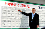 Hiroyuki Hosoda, secretary-general of Japan's ruling Liberal Democratic Party and prime minister of Japan, places a ribbon indicating the first gain of a constituency for his party during Japan's general election at the LDP's headquarters in Tokyo, Japan on Sunday 30 August 2009..