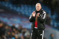 Swansea City Manager Alan Curtis applauds the fans at the end of the Barclays Premier League Match between Manchester City and Swansea City played at the Etihad Stadium, Manchester on 12th December 2015