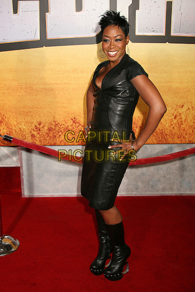 "TICHINA ARNOLD.""Wild Hogs"" Los Angeles Premiere at the El Capitan Theatre, Hollywood, California, USA..February 27th, 2007.full length black skirt top boots leather hands on hips heels rings hoops shoes .CAP/ADM/BP.©Byron Purvis/AdMedia/Capital Pictures"