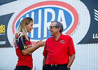 Sep 3, 2017; Clermont, IN, USA; NHRA top fuel driver Leah Pritchett (left) with team owner Don Schumacher during qualifying for the US Nationals at Lucas Oil Raceway. Mandatory Credit: Mark J. Rebilas-USA TODAY Sports