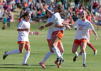 Virginia's Molly Menchel (13), middle right,  gives a hug to teammate Morgan Brian(6), middle left, after she scored the first goal during the first round of the ACC Tournament against Maryland Sunday at Klockner Stadium.  Virginia defeated Maryland 6-1. Photo/The Daily Progress/Andrew Shurtleff