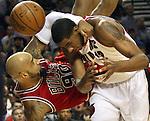 Bulls Drew Gooden tumbles over Blazers LaMarcus Aldridge in the first half of the Blazers win over the Bulls.