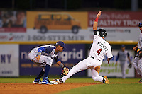 Brooklyn Cyclones shortstop Alfredo Reyes (8) puts the tag on Alexander Melendez (4) sliding into second during a game against the Tri-City ValleyCats on September 1, 2015 at Joseph L. Bruno Stadium in Troy, New York.  Tri-City defeated Brooklyn 5-4.  (Mike Janes/Four Seam Images)