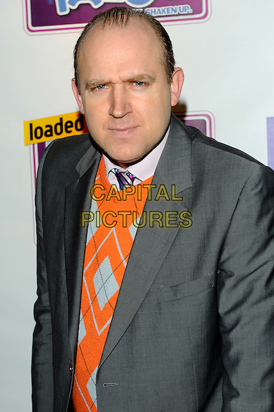 Tim Vine.Loaded Laftas at the Cuckoo Club, Piccadilly, London, England..February 8th, 2012.half length grey gray orange argyle jumper sweater .CAP/CJ.©Chris Joseph/Capital Pictures.