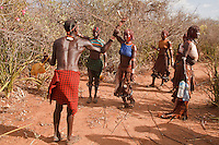 Hamer girl whipping during the bull jumping ceremony in Omo valley Ethiopia