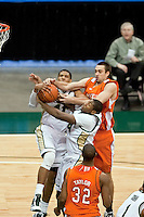 February 25, 2010:    Jacksonville forward Lehmon Colbert (41) fights for a rebound during Atlantic Sun Conference action between the Jacksonville Dolphins and the Campbell Camels at Veterans Memorial Arena in Jacksonville, Florida.  Jacksonville defeated Campbell 65-52.