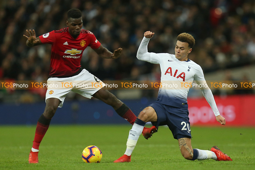 Paul Pogba of Manchester United catches Dele Alli of Tottenham Hotspur with a late tackle during Tottenham Hotspur vs Manchester United, Premier League Football at Wembley Stadium on 13th January 2019