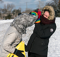 Braving cold wind whipped snow at Centennial Park, Boxing Day.